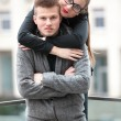 Sexy woman with red lipstick hugging from behind her boyfriend — Stok fotoğraf