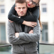 Sexy woman with red lipstick hugging from behind her boyfriend — Stock fotografie
