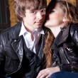 Woman whispering on boyfriends ear on street — Stockfoto