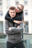 Sexy woman with red lipstick hugging from behind her boyfriend — Stock Photo