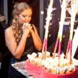 Happy girl making wish near birthday cake — Stock Photo