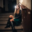 Beautiful girl sitting on stairway at old building — Stock Photo #36729411