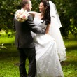 Wedding couple hugging and looking at each other at garden — Stock Photo #36791749