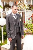 Groom in suit waiting bride on restaurant terrace — Stock Photo
