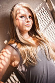 Sexy blond girl in singlet with shadow falling face — Stock Photo