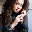 Portrait of woman in blouse and dark curly hair — Stock Photo