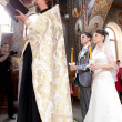 Couple getting married in church by orthodox priest — Stok fotoğraf