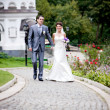 Married couple holding hands while walking in park — Stock Photo #37195419