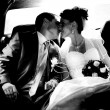 Portrait of just married couple kissing in car — Stock Photo