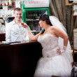 Brunette bride talking to barman at bar desk — Stock Photo