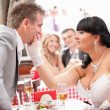 Stock Photo: Newly married couple quarreling at restaurant