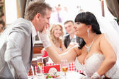 Newly married couple quarreling at restaurant — Stock Photo