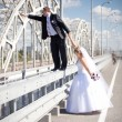 Young groom running away from bride — Stock Photo #40639055