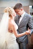 Portrait of bride and groom dancing waltz — Stock Photo