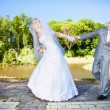 Bride holding grooms hand and leading him — Stock Photo #41614425