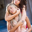 Portrait of brunette girl hugging from back blonde girl — Stock Photo