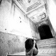Depressed lonely woman sitting on stairs at abandoned building — Stock Photo #41819069