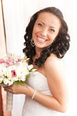 Portrait of beautiful laughing brunette bride — Stock Photo