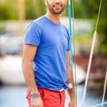Stylish latin man sailing on yacht — Stock Photo