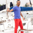 Portrait of sexy man standing on white yacht — Stock Photo #42160085