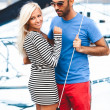Latin man hugging sexy blonde woman on yacht — Stock Photo #42160129