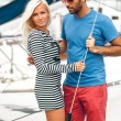 Handsome latin man and blond woman standing on yacht — Stock Photo #42160135