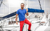 Latin man standing on yacht and looking at stormy sky — Stockfoto