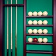 Billiard stand with cues and balls — Stock Photo