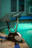 Exercise bike standing at swimming pool — Stock Photo