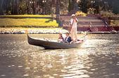 Married couple riding on gondola on river — Stock Photo