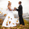 Married couple holding hands at autumn windy day — Stok fotoğraf
