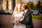 Mid-aged bride and groom standing on street — Stock Photo