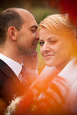 Shot with orange flares of newly married couple — Stock Photo