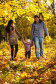 Family walking at park with small daughter — Stock Photo