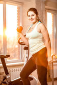 Young woman working out at fitness club — Stock Photo