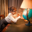 Little girl looking patiently at globe — Stock Photo