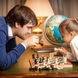Handsome man playing chess with girl — Stock Photo #43227881