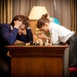 Man lost chess game with smart little gir — Stock Photo