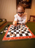 Genius girl playing chess at luxurious room — Foto Stock