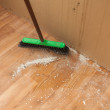 Cleaning debris on floor by brush — Stock Photo #43419843
