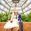 Photo of bride and groom at tropical orangery — Stock Photo #43438173