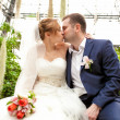 Just married couple kissing at orangery — Stock Photo
