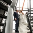 Married couple standing on top of metal stairs — Stock Photo #43438313
