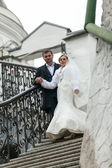 Married couple descending old stone stairway — Stock Photo