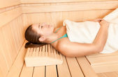 Woman lying with closed eyes at steam bath — Stock Photo