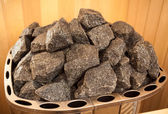 Photo of granite rocks on oven at sauna — Stock Photo