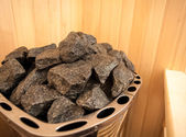 Mage of granite rock in sauna oven — Stok fotoğraf