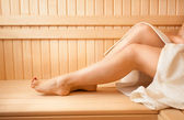 Photo of sexy women feet on bench at sauna — Stok fotoğraf