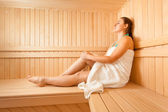 Woman lying on bench at scandinavian sauna — Stock Photo