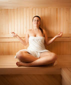 Woman meditating on bench at sauna — Foto Stock